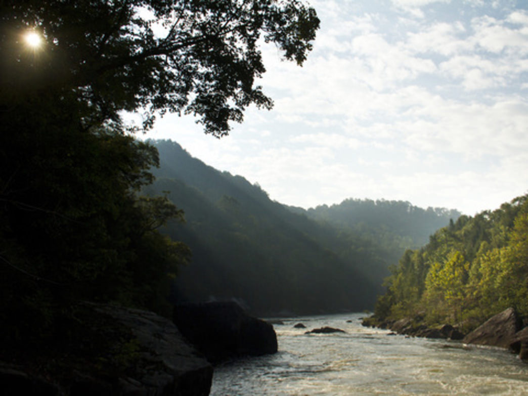 The sun rises over the rim of the Gauley River Gorge.