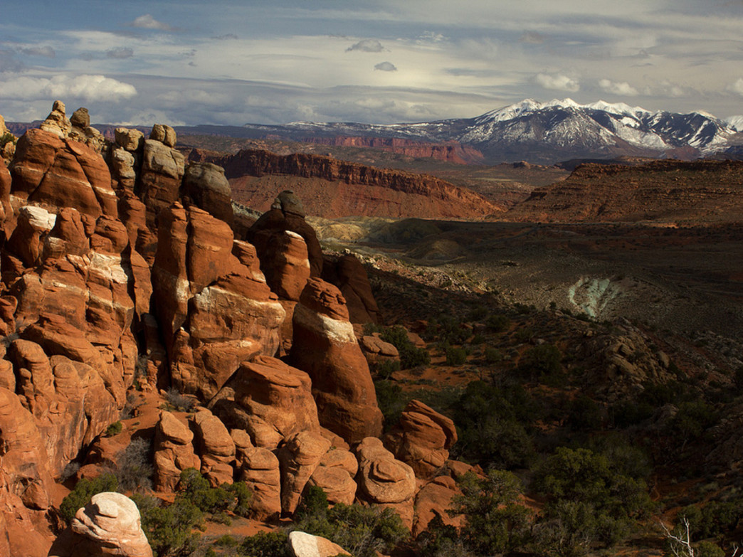 Snow-covered peaks high in the La Sals add a cooler element to the Fiery Furnace landscape.