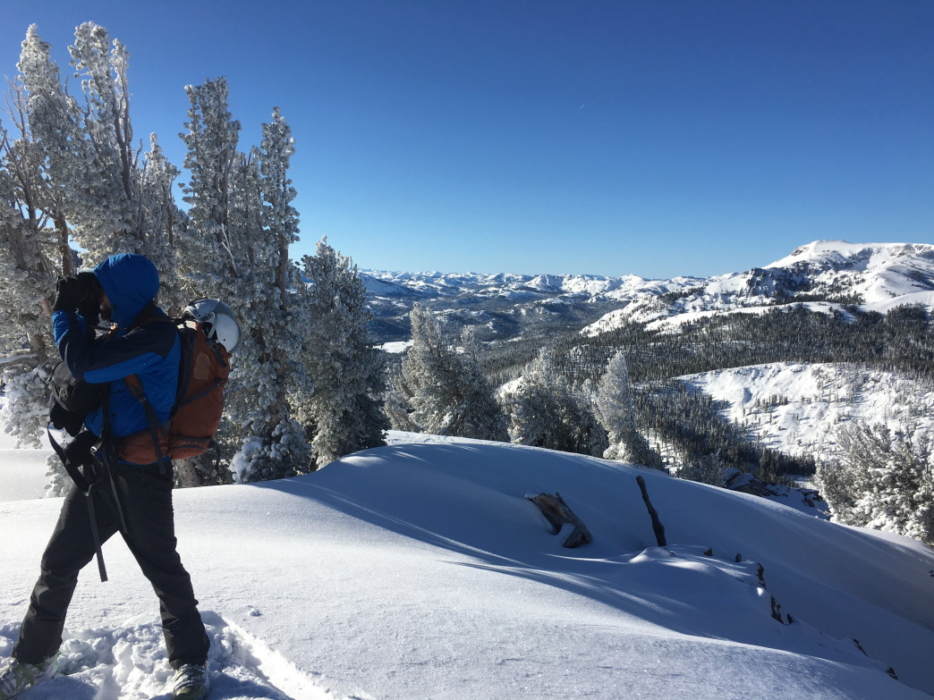 A backcountry skier scouts options for a post-ski beer.