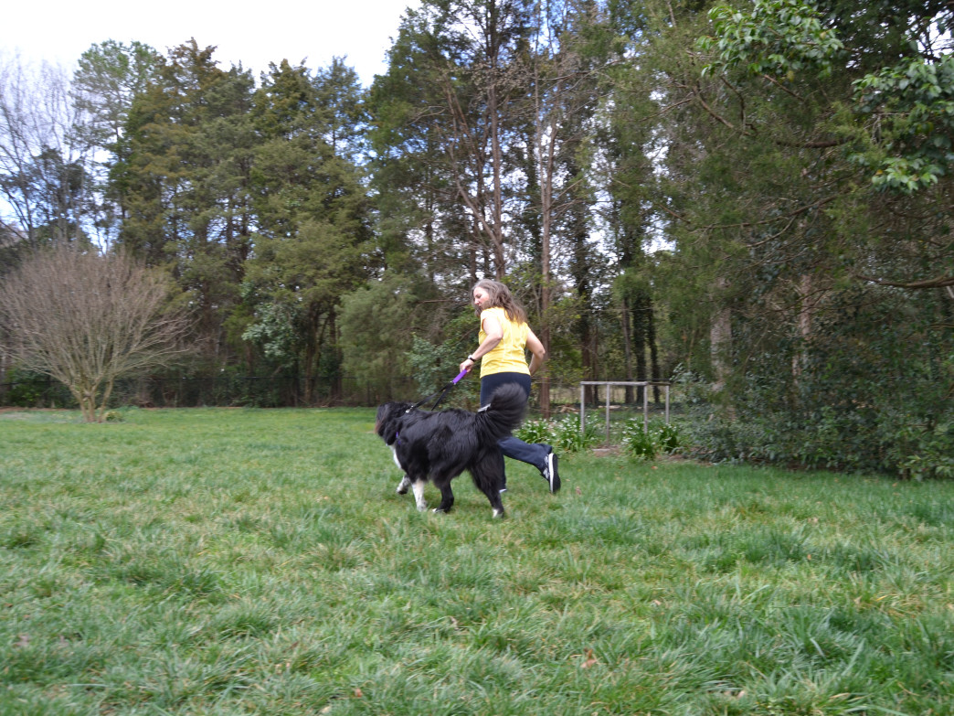 Molly Dudick Runs with her pup. The physical therapist believes in the power of movement to maintain back health