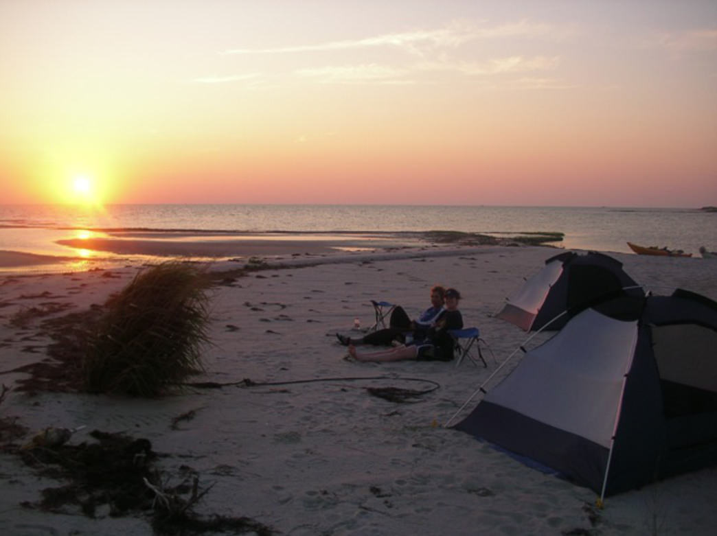 Kayak out to a remote spit of land in the Chesapeake Bay or Atlantic Ocean and set up a homestead.       Burnham Guides