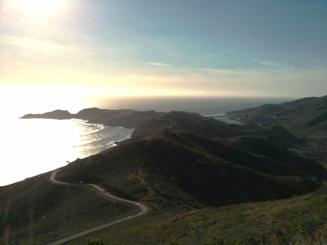 The road descends towards campsites in the Marin Headlands.