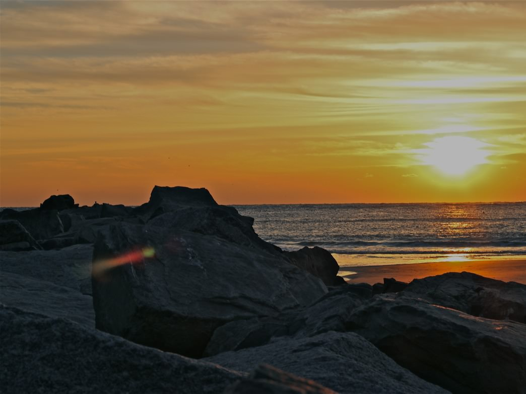 Sunrise over the inlet at New Smyrna Beach, FL.