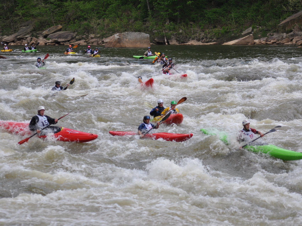 Paddlers enter Big Nasty Rapid during an annual Cheat River Race.