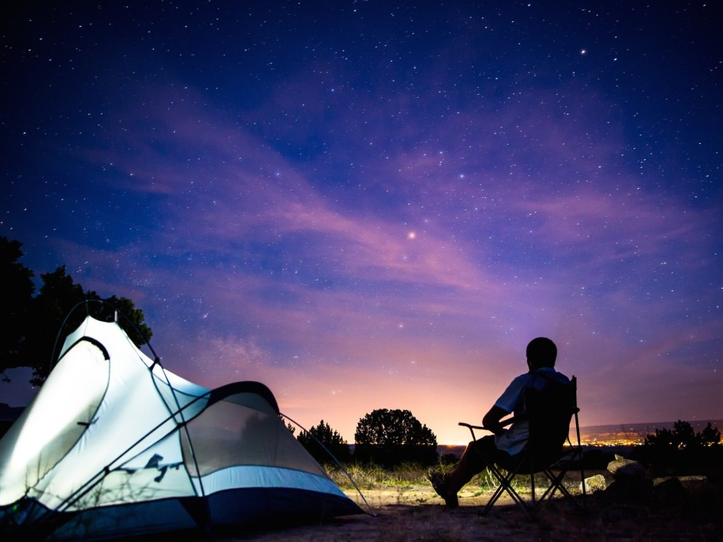 Camping is great for stargazing, but so's your backyard. Either way, your eyes are your best starting point.