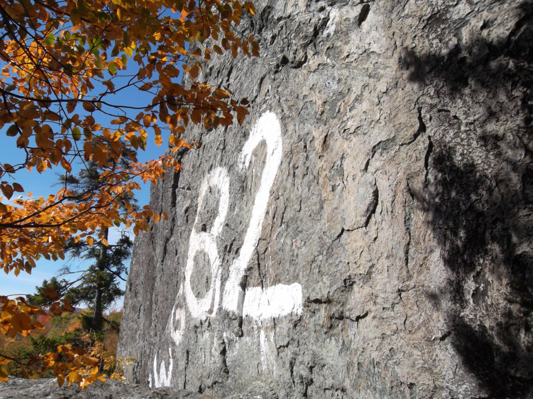 Iconic spray-painted 82 on the crag's Steep Face.