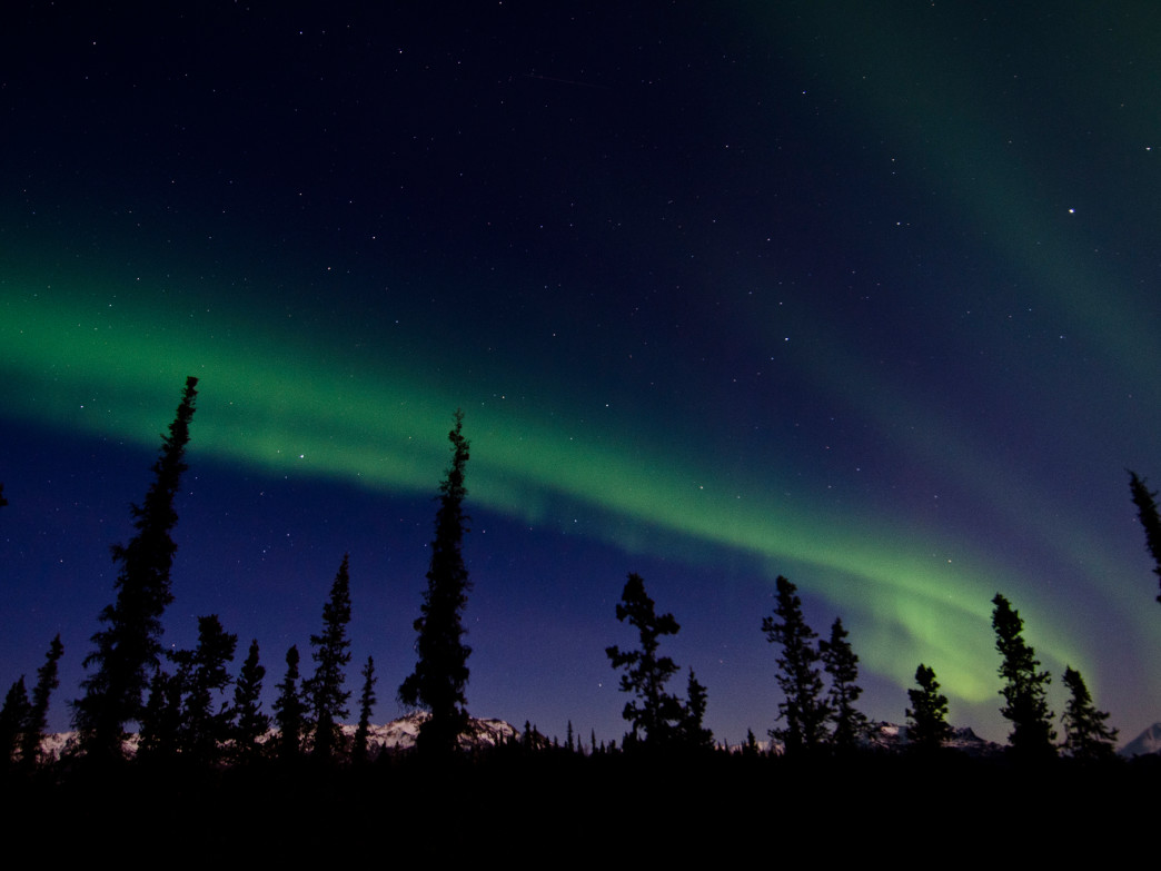 The northern lights streak across the sky.