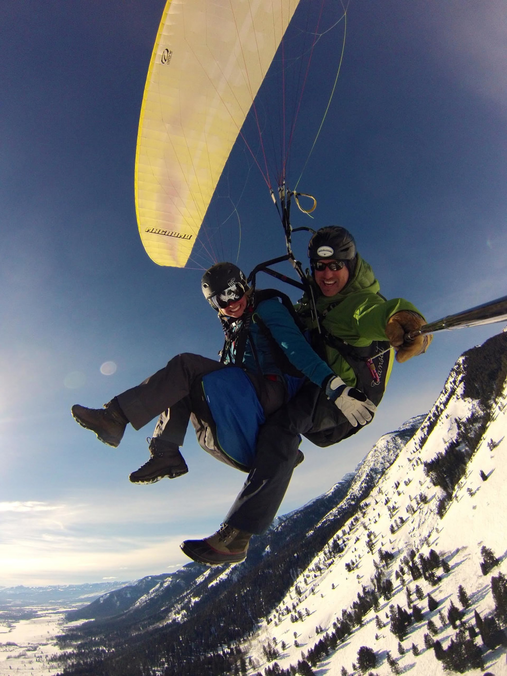 Soar high above the Tetons on a paragliding adventure.