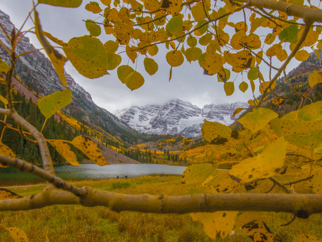 "The Maroon Bells earn their title of ""most photographed place in Colorado"" when the fall colors dress up the view."