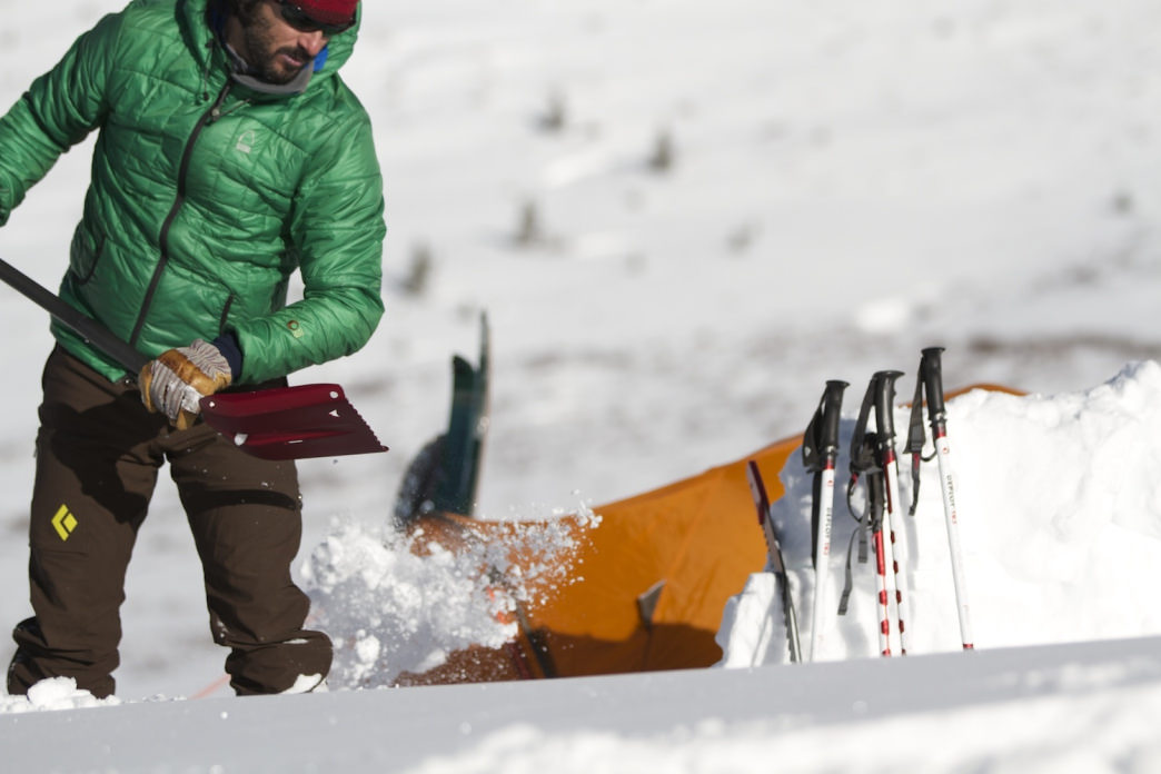 Pack a shovel when winter camping to dig snow pits and style your campsite.
