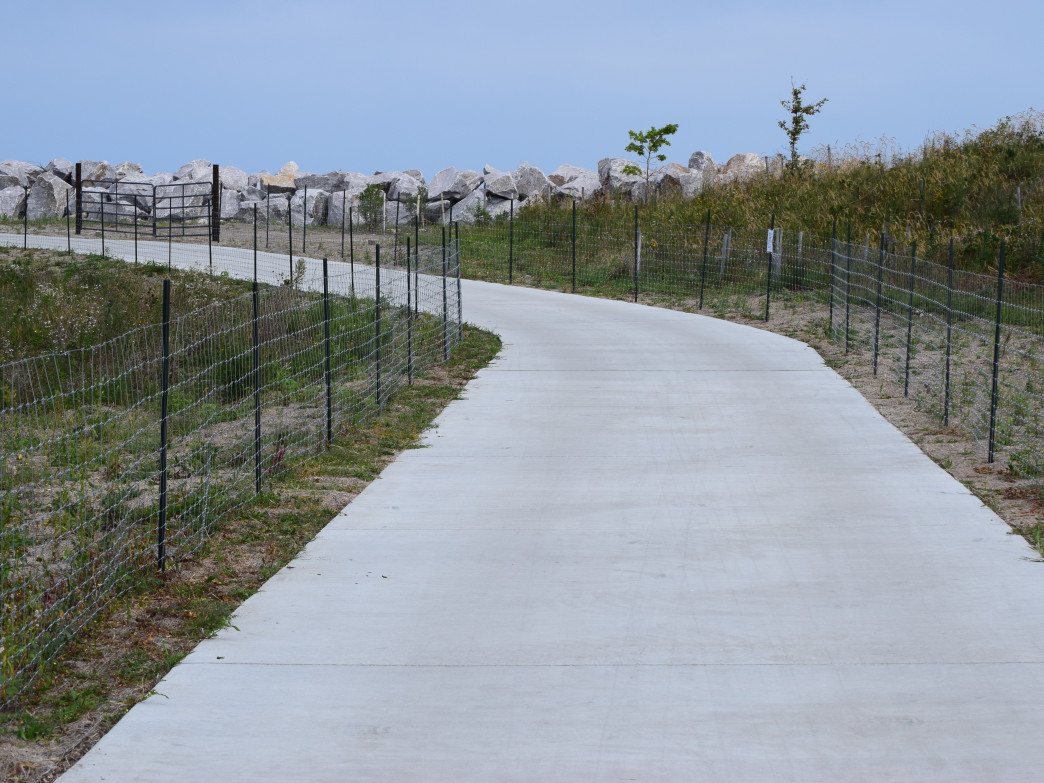 The mile-long path around the lagoon on Northerly Island is surrounded by a fence, keeping people off the newly planted vegetation.