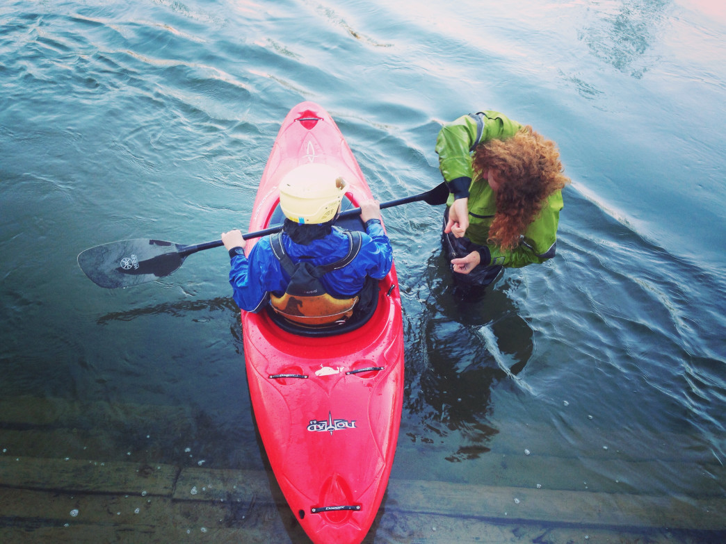 A brand new kayaker learns to roll on the French Broad River.