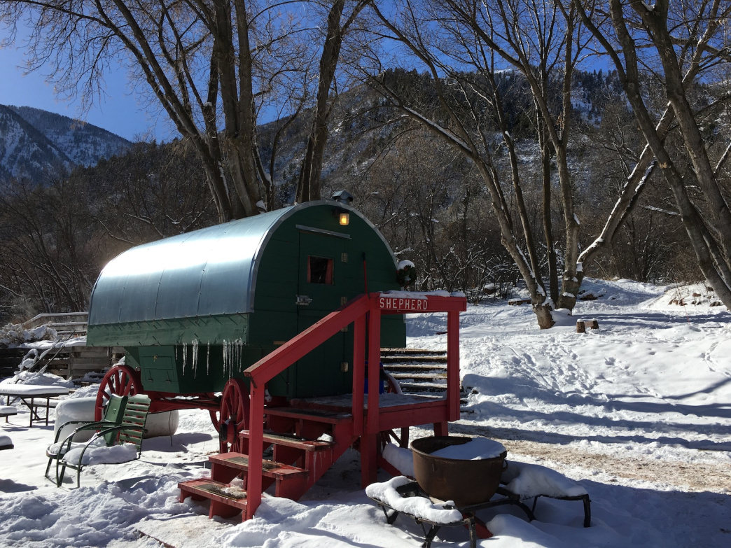 At Avalanche Ranch, you can catch winks in a cute covered wagon—or opt for a cabin, all within a short stroll to their private hot spring pools.