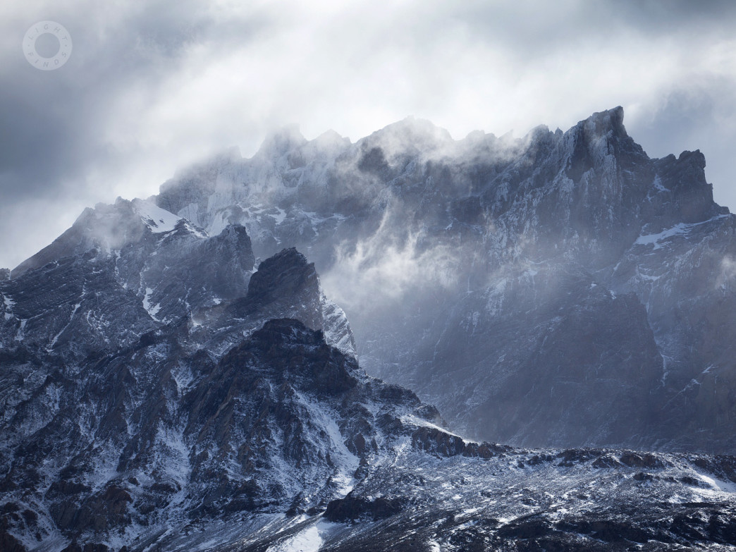 Jagged peaks cut through the clouds at Torres del Paine