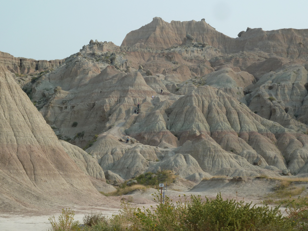 Climbing up and over the jagged formations at Badlands National Park tests legs but offers incredible views.