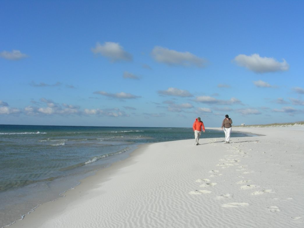A couple enjoys the solitude of the beach at the end of the Pine Beach Trail in the Bon Secour National Wildlife Refuge.