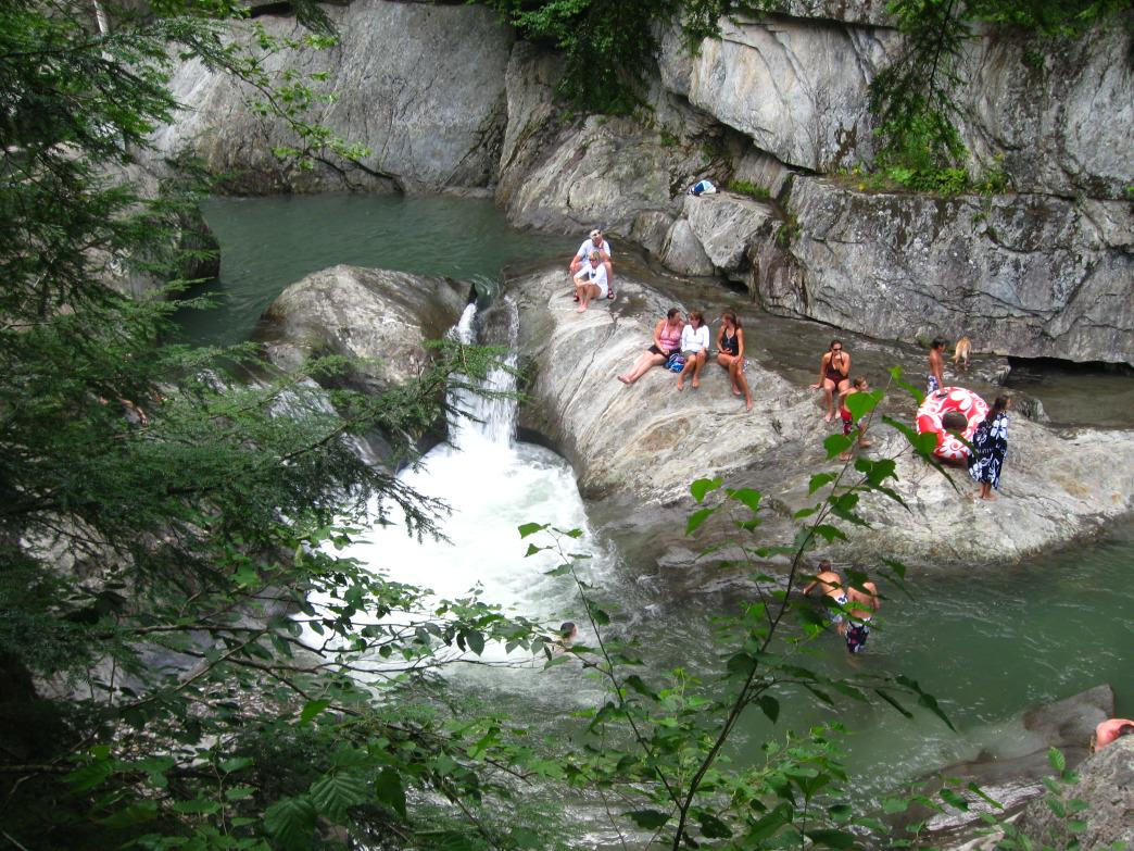 Crowds relaxing in the waters of Warren Falls