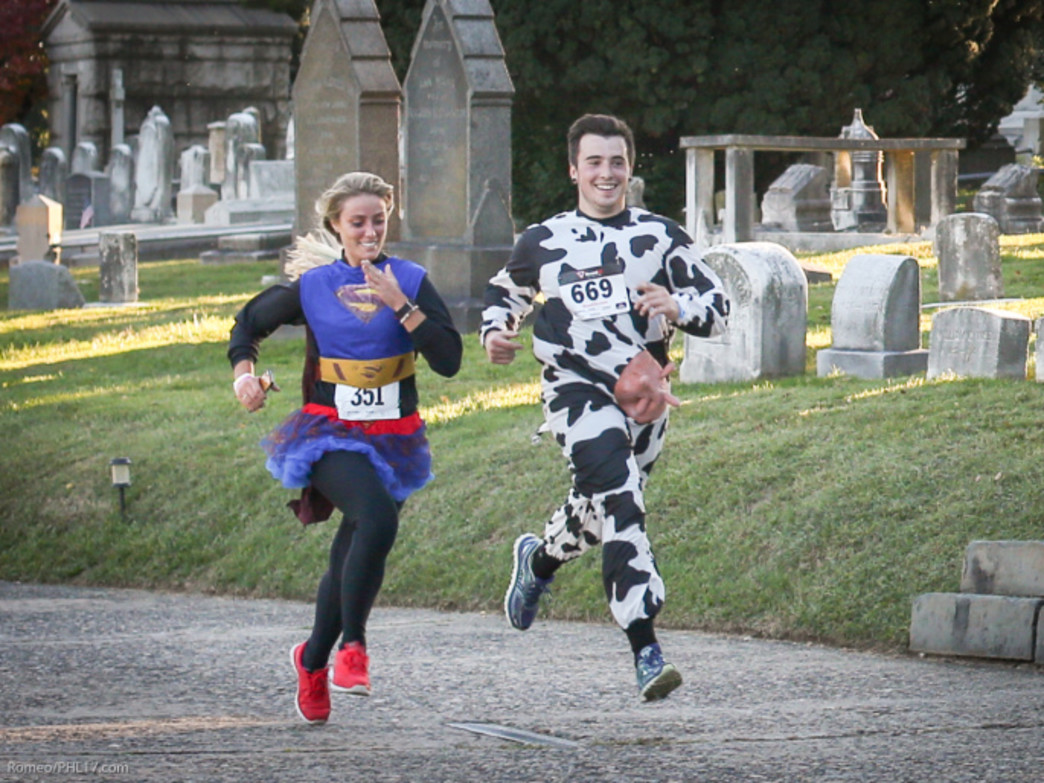 Runners race through Laurel Hill Cemetery.
