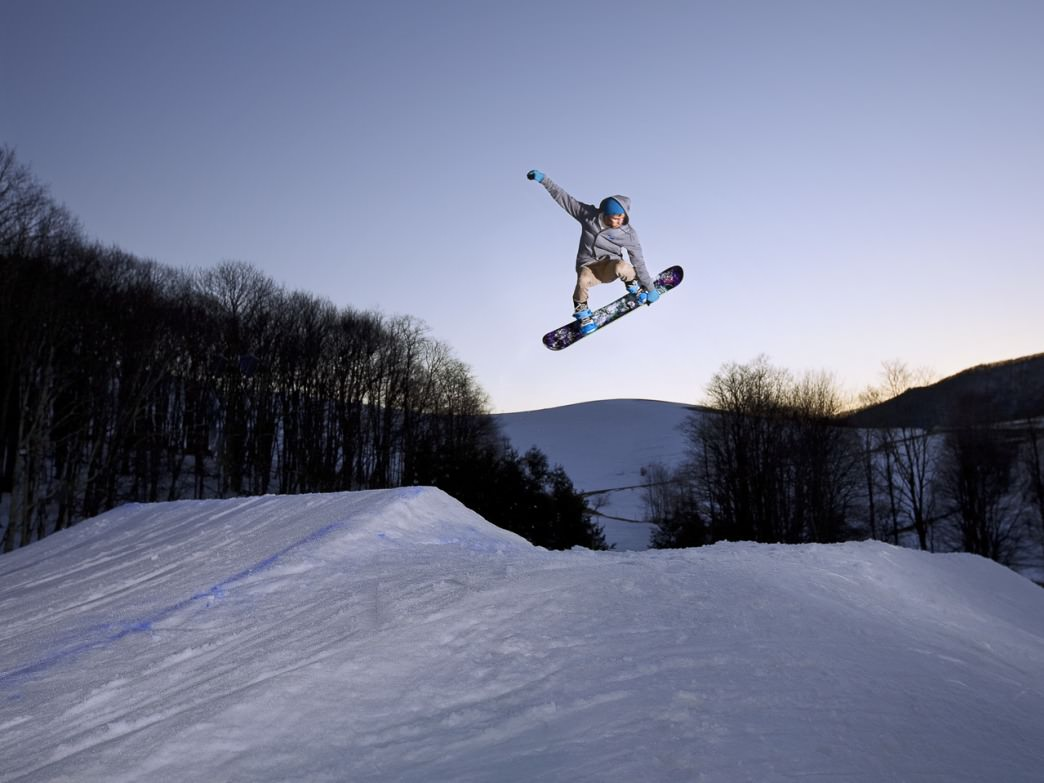 Snowboarder in Cat Cage Terrain Park at Cataloochee.