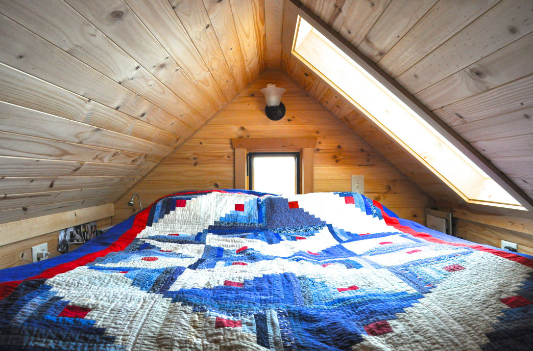 A loft for a bed is an efficient use of interior space.