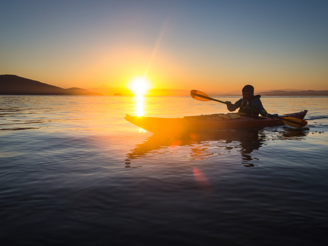 Sunrise from a sea kayak in the San Juan Islands, Washington.