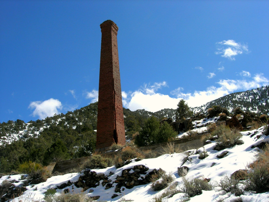 A smokestack rises from the mining ruins of Panamint City.