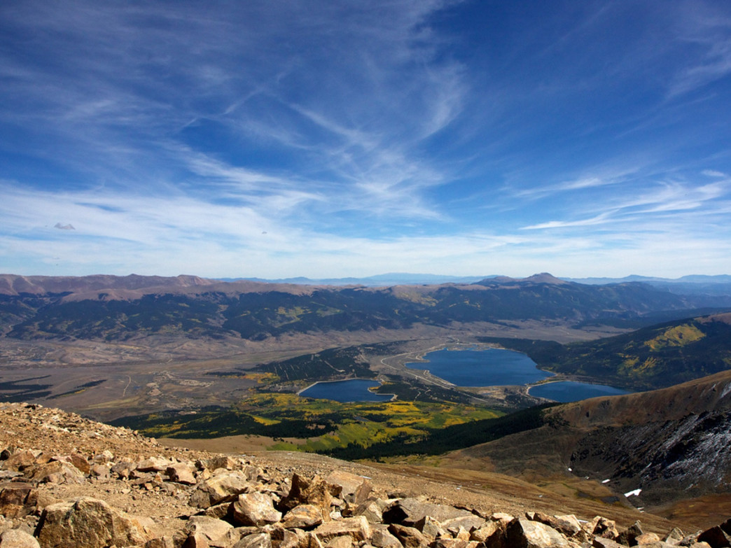 From the summit, Twin Lakes, and Pikes Peak on the horizon.