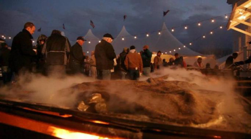 Oysters roasting at dusk