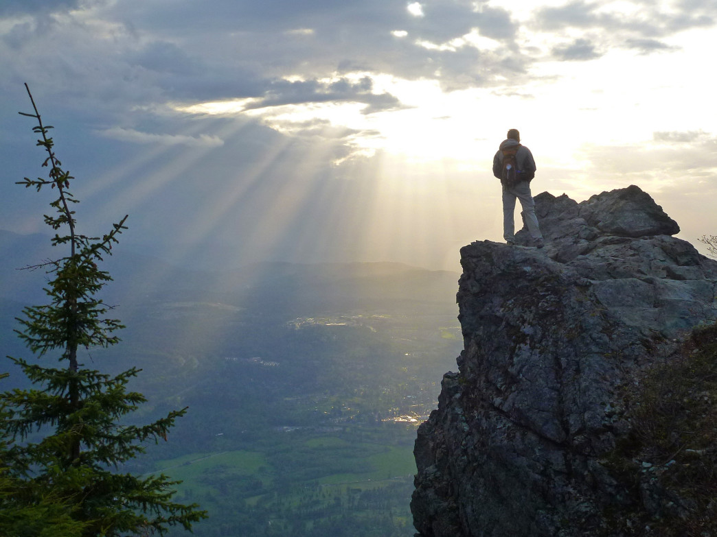 A hiker takes in the from from the top of Mount Si, just outside Seattle.