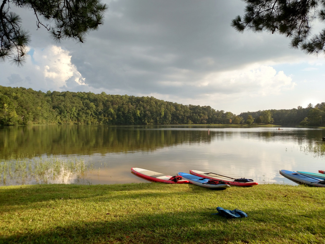 Lake Nicol greets paddlers with calm waters, lush forest and towering bluffs.