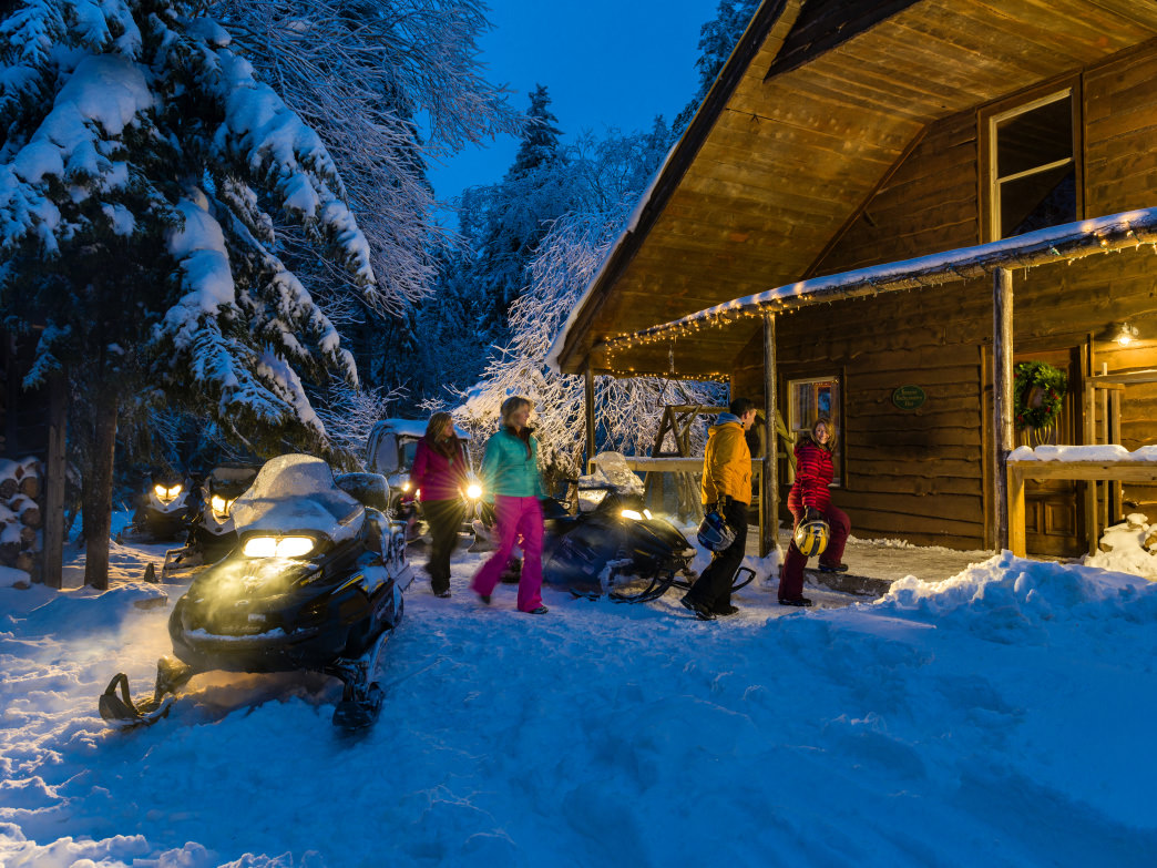 Take a snowmobile out to the Backcountry Hut.