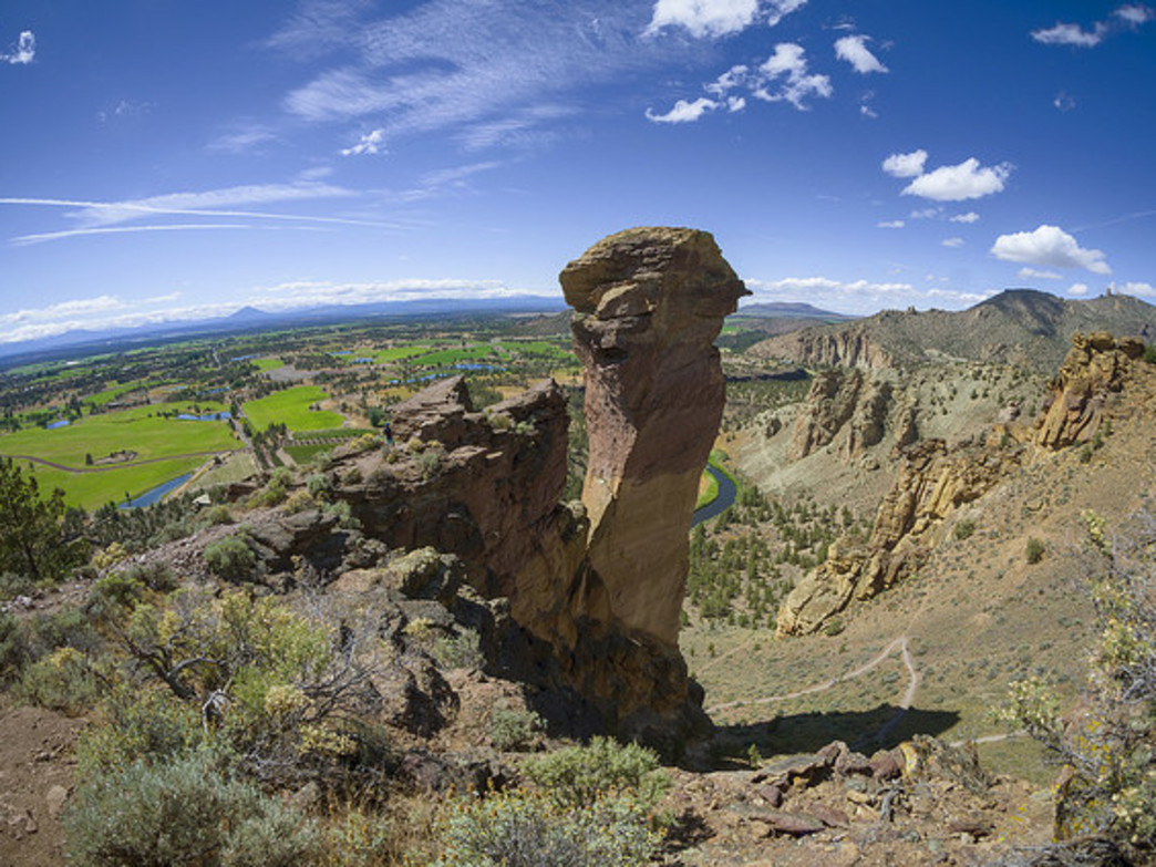 One of the most-photographed locations in Smith Rock State Park is Monkey Face, a rocky outcrop that also challenges adventurous rock-climbers. Mount Jefferson and Oregon's high desert are visible from the viewpoint.