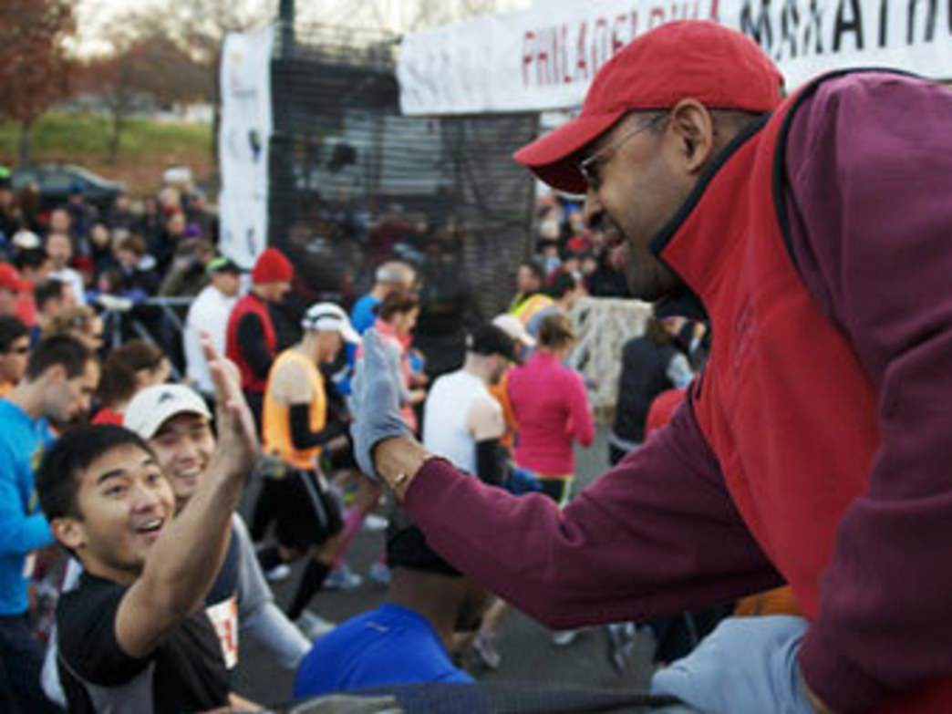 Mayor Nutter gives high fives to race finishers at the Philly Marathon.