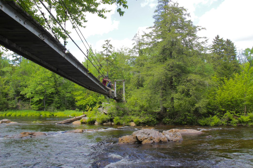 The suspension bridge stretching across the West Branch of the Sacandaga River makes for a great place to take a break.     Grant Sponable