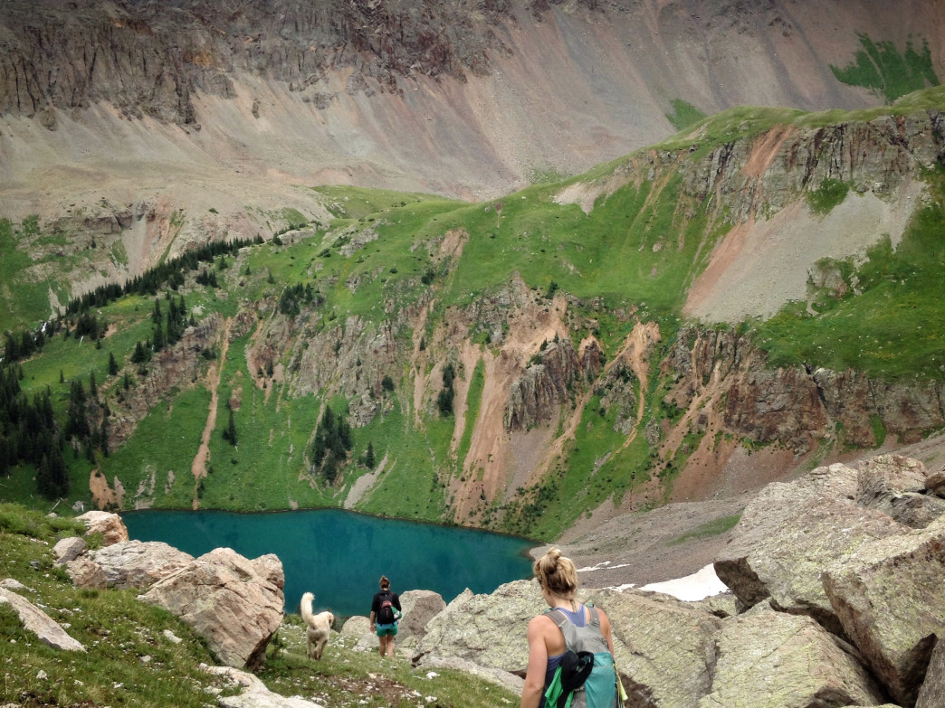 Hikers descend through wildflowers to lower Blue Lake