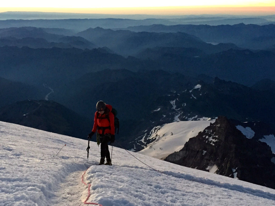 Watching the sunrise is one of the best moments on a Mount Rainier climb.