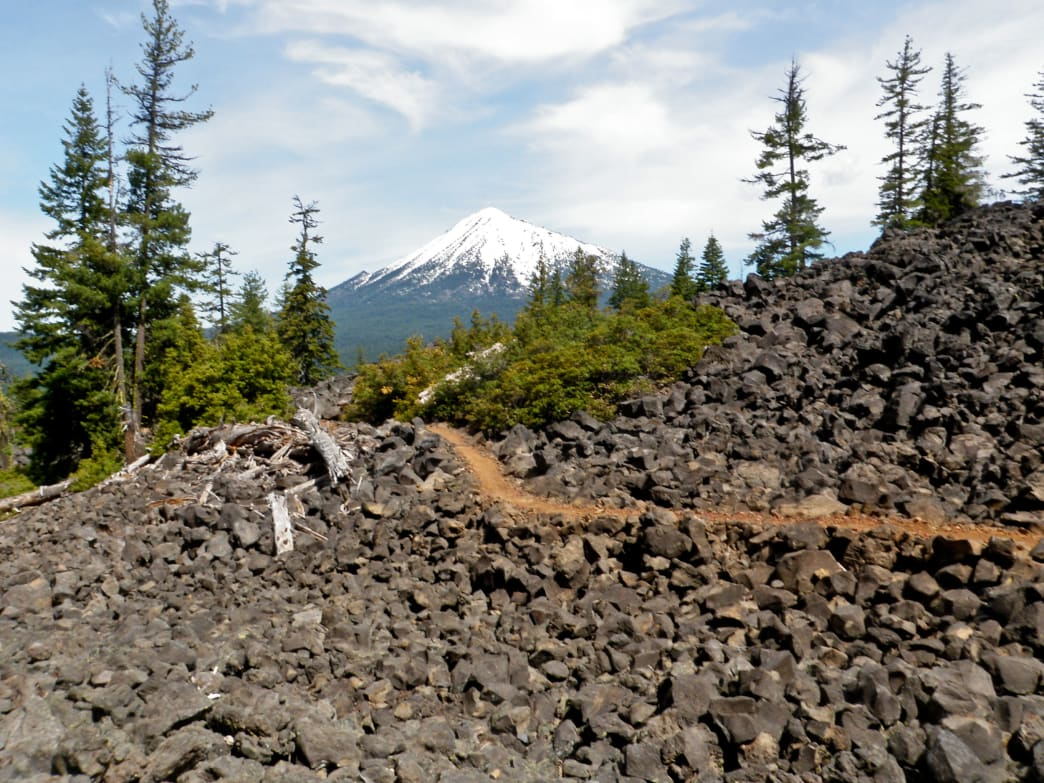 The Brown Mountain Loop Trail features both old-growth forest and lava fields in addition to stunning scenery of the surrounding mountains.