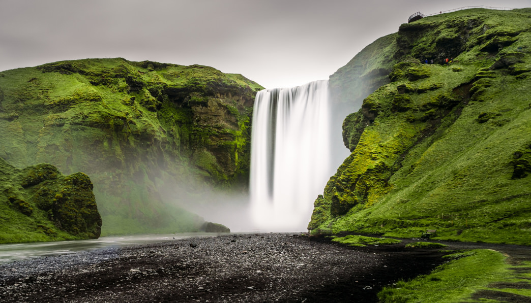 Visit waterfalls like Skógafoss on a family trip to Iceland.