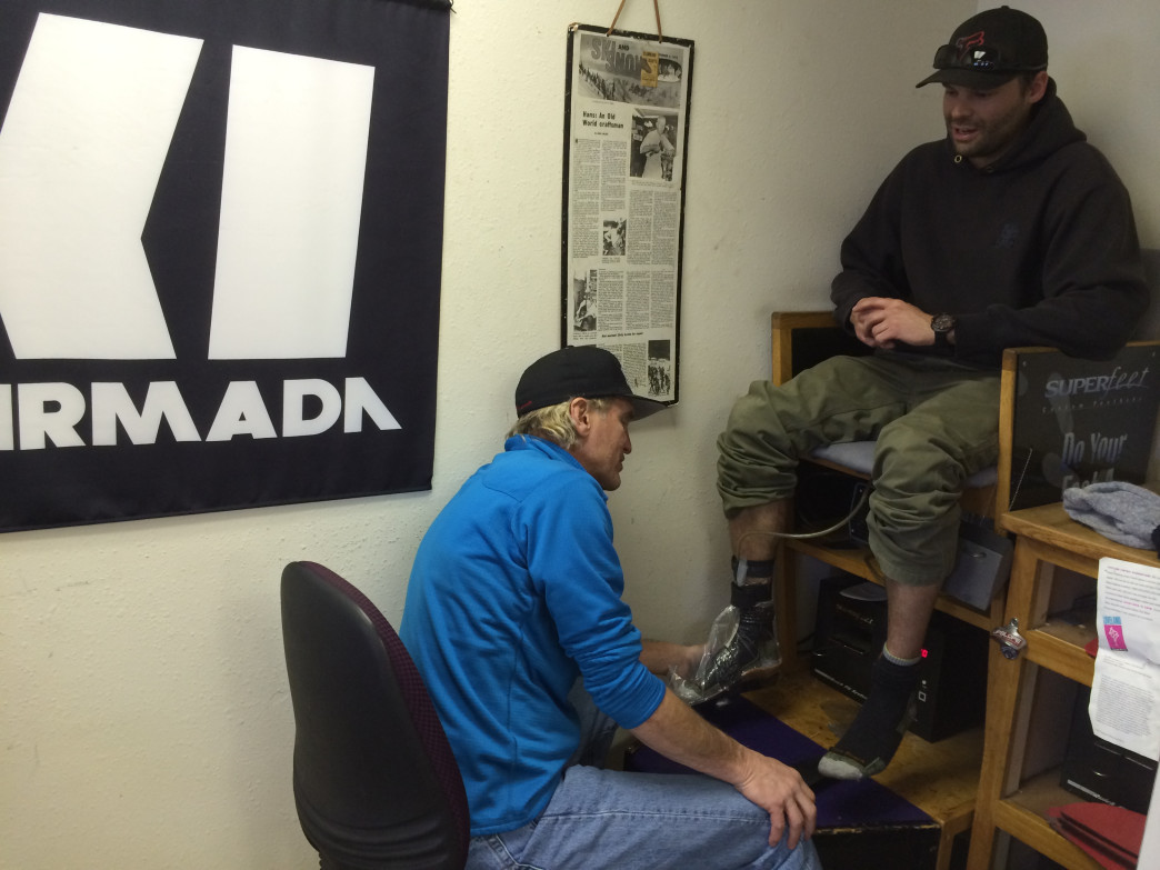 Larry chats with a customer while working on a custom footbed
