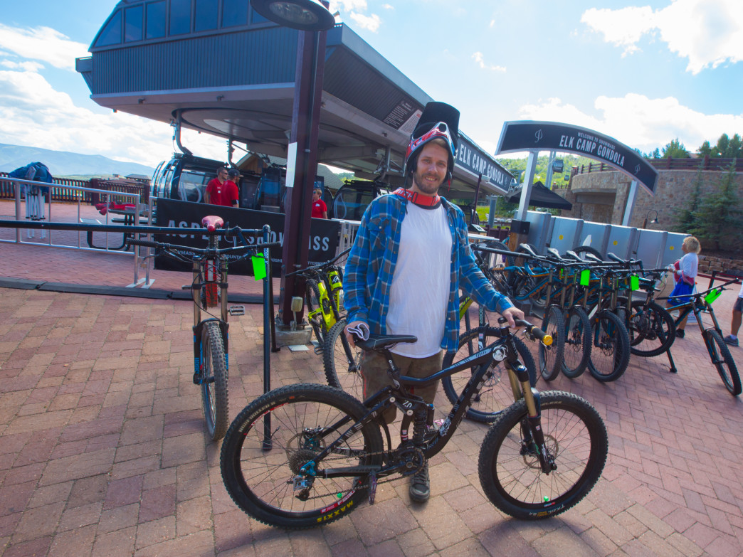 Karczewski poses outside Four Mountain Sports, where he works as a rental bike technician.