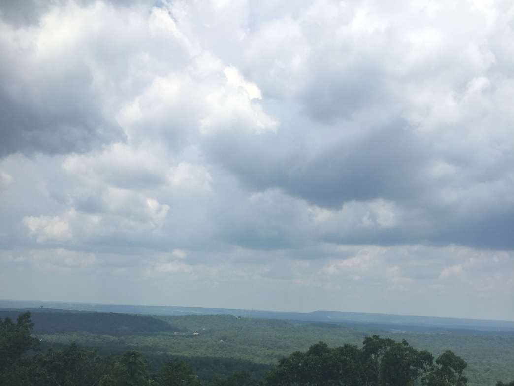 Clouds roll in over the horizon from Oak Mountain.