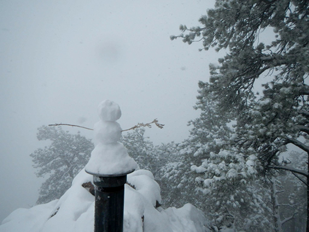 Snowman on the stormy summit of Mount Sanitas.