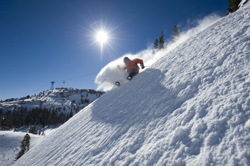 Spring skiing at Squaw  Valley Alpine Meadows means plenty of bluebird skies.