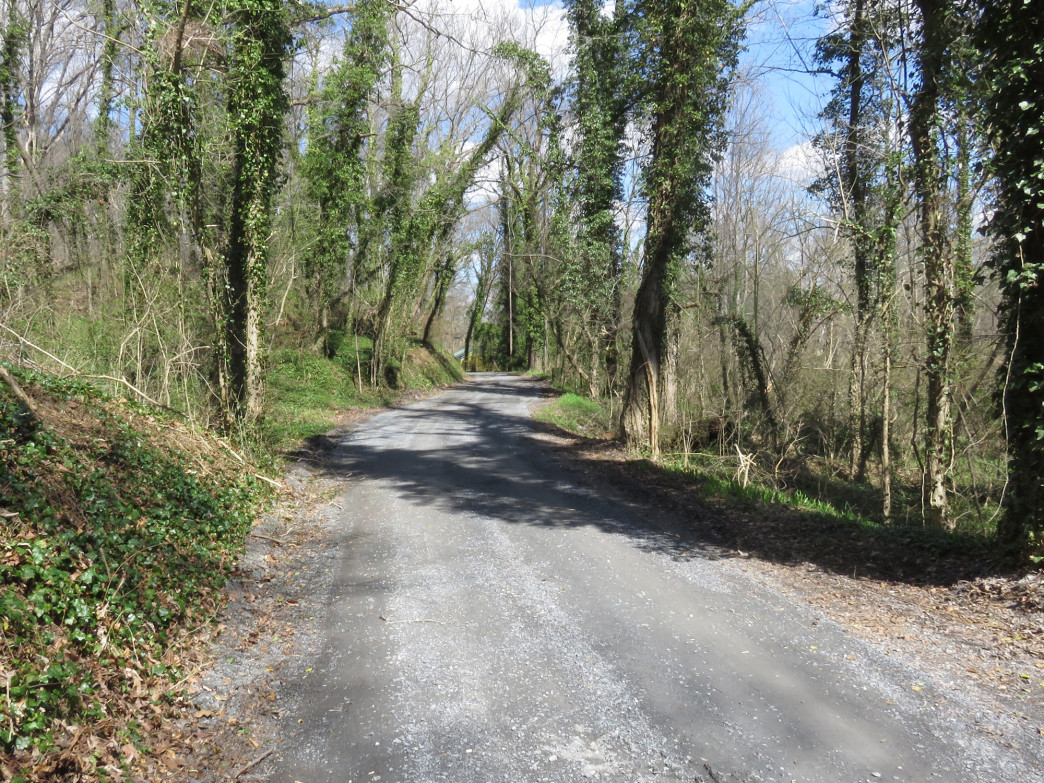 The Seneca Creek Greenway Trail shares real estate with a gravel road at milepost 0.