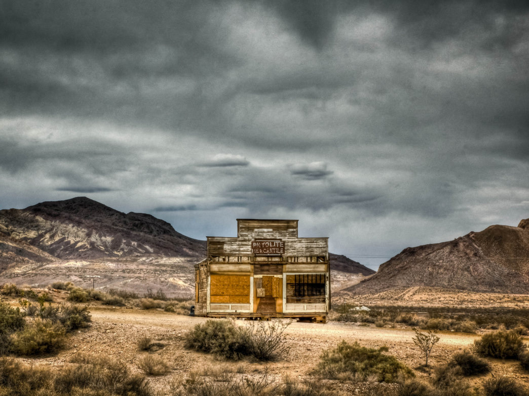 The abandoned Rhyolite Mercantile store standing lonesome and proud in the Nevada desert.
