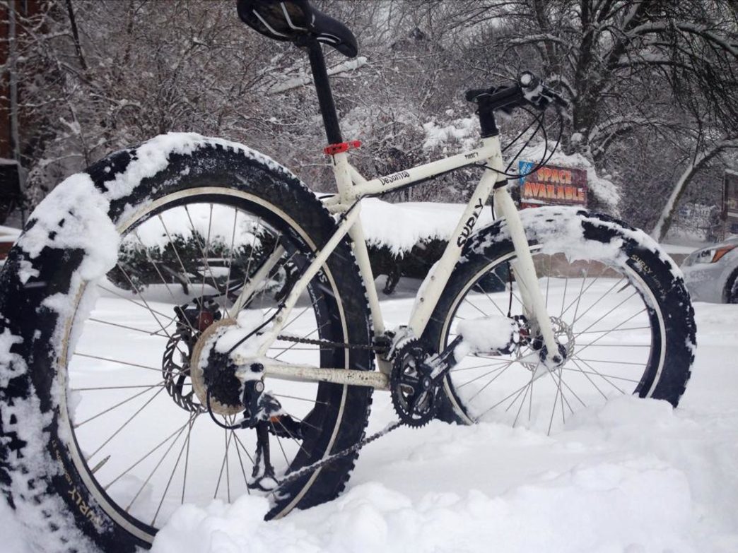 A fat tire bike sits ready for action on the snowy trails.