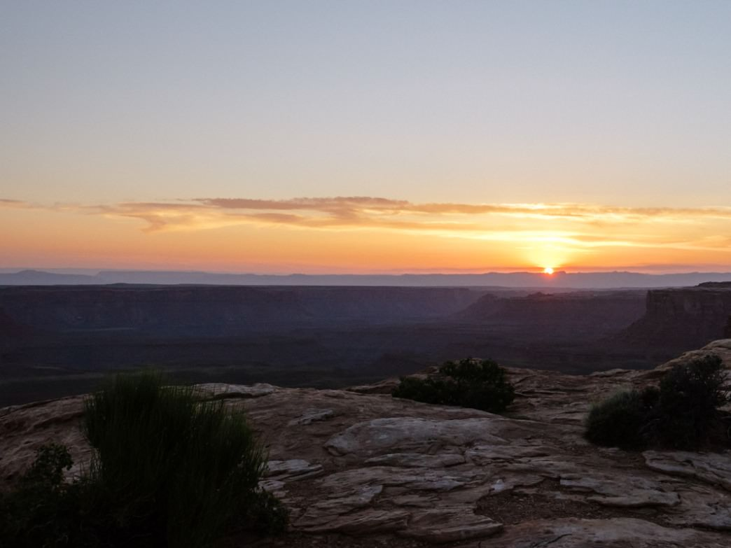 The sun sets below the canyons of Muley Point.