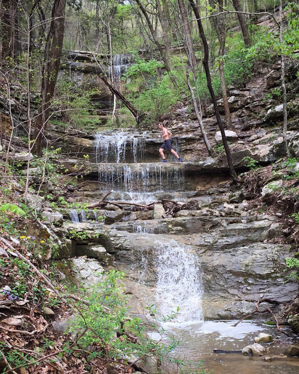 A runner crosses Dry Falls on Waterline Trail at Monte Sano Preserve.