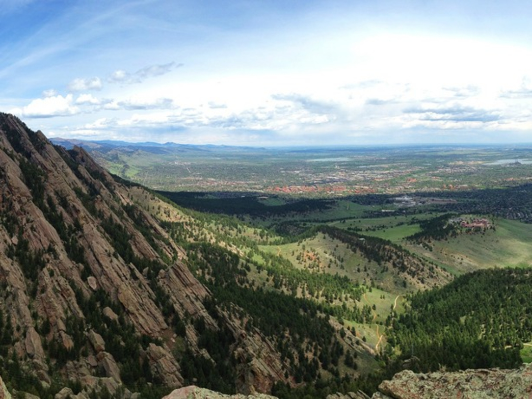 Enjoying a summit view after a climb in the Flatirons