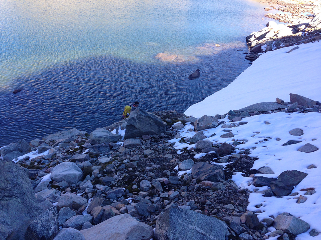 The author bypasses the notorious snowfield by walking through the lake.
